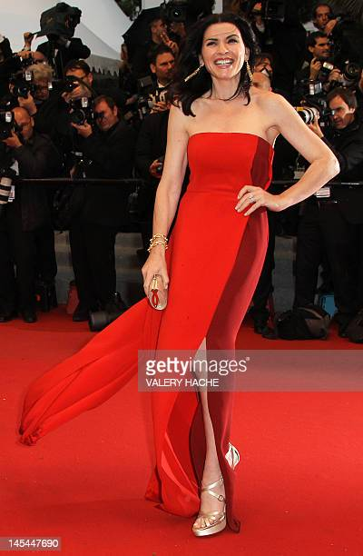 """Actress Julianna Margulies poses as she arrives for the screening of the film """"Cosmopolis"""" presented in competition at the 65th Cannes film festival..."""