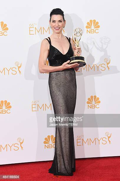 Actress Julianna Margulies winner of the Outstanding Lead Actress in a Drama Series Award for The Good Wife poses in the press room during the 66th...