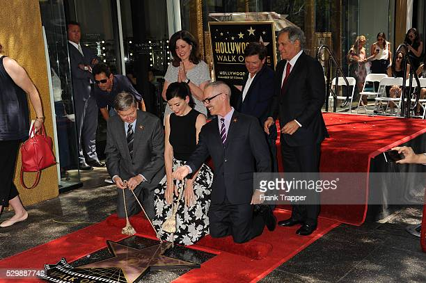 Actress Julianna Maugulies and guests pose at the ceremony that honored her with a Star on the Hollywood Walk of Fame