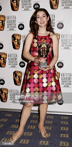 Actress Julianna Rose Mauriello poses with the International award for 'Lazy Town' in the awards room at the 11th British Academy Children's Film...