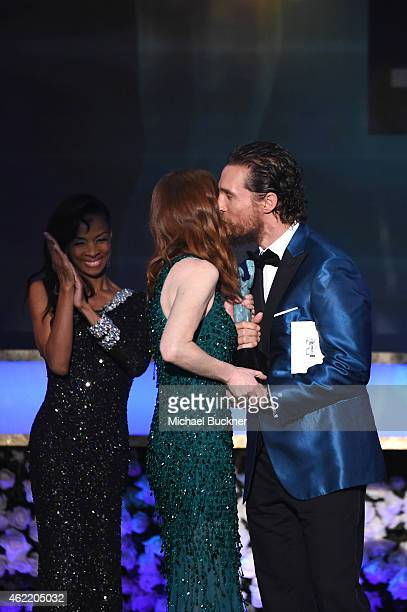 Actress Julianne Moore accepts an award from actor Matthew McConaughey onstage during TNT's 21st Annual Screen Actors Guild Awards at The Shrine...