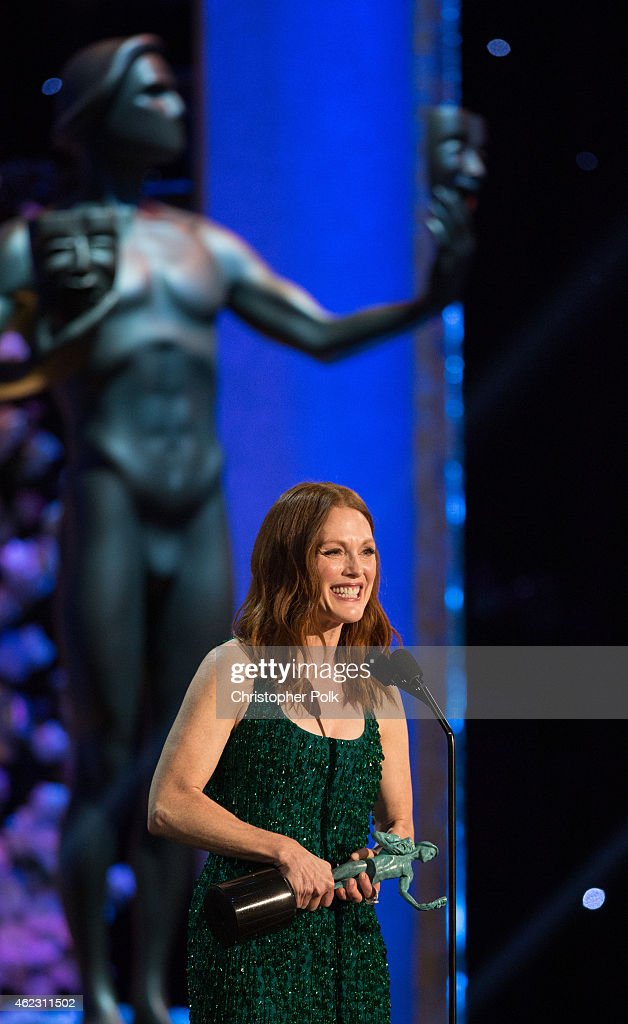 Actress Julianne Moore accepts the award for Outstanding Performance by a Female Actor in a Motion Picture during TNT's 21st Annual Screen Actors Guild Awards at The Shrine Auditorium on January 25, 2015 in Los Angeles, California. 25184_013