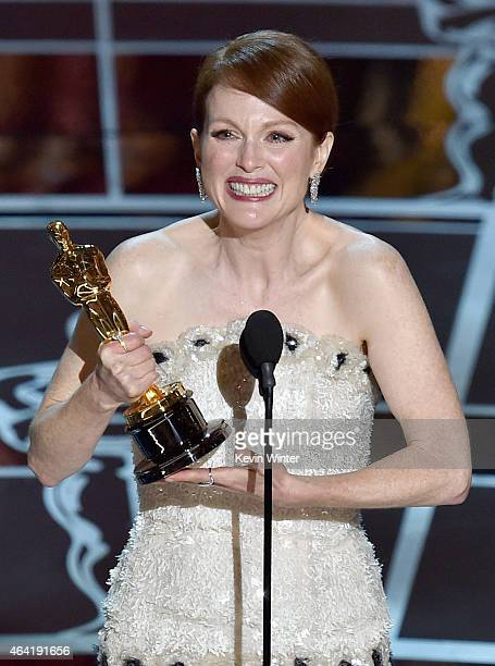 """Actress Julianne Moore accepts the Best Actress in a Leading Role Award for """"Still Alice"""" onstage during the 87th Annual Academy Awards at Dolby..."""