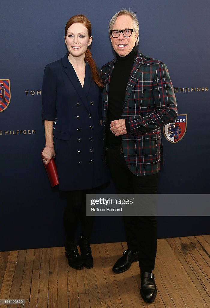 Actress Julianne Moore and designer Tommy Hilfiger backstage at the Tommy Hilfiger Fall 2013 Women's Collection fashion show during Mercedes-Benz Fashion Week at the Park Avenue Armory on February 10, 2013 in New York City.