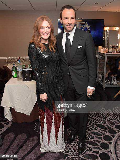 Actress Julianne Moore and director Tom Ford pose in the green room during the Hollywood Film Awards on November 6 2016 in West Hollywood California