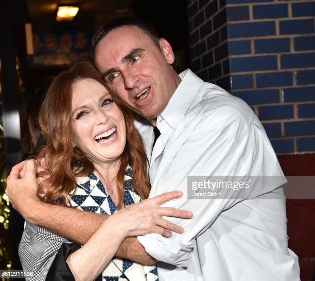 Actress Julianne Moore and Raf Simons attend Raf Simons Front Row during NYFW Men's at Golden Sun Life Day Care on July 11 2017 in New York City