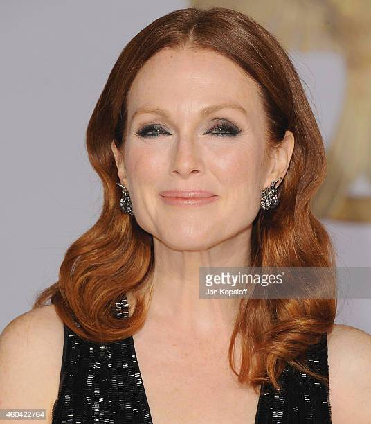 Actress Julianne Moore arrives at the Los Angele Premiere The Hunger Games Mockingjay Part 1 at Nokia Theatre LA Live on November 17 2014 in Los...