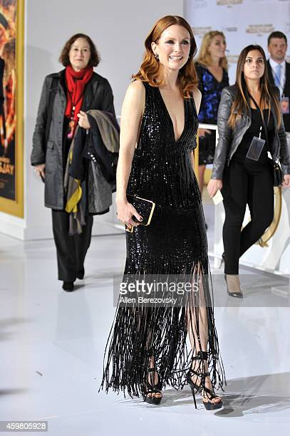 Actress Julianne Moore arrives at the Los Angeles premiere of The Hunger Games Mockingjay Part 1 at Nokia Theatre LA Live on November 17 2014 in Los...