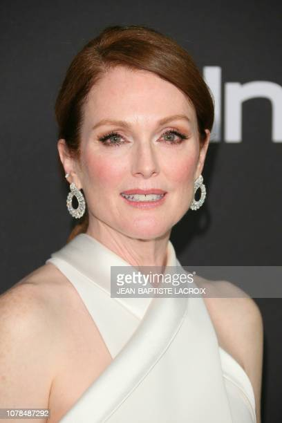 US actress Julianne Moore arrives for the Warner Bros and In Style 20th annual post Golden Globes party at the Oasis Courtyard of the Beverly Hilton...