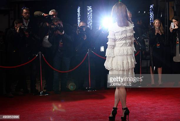 """Actress Julianne Moore arrives on the red carpet to attend the UK Premiere of the film """"The Hunger Games: Mockingjay Part 2"""" in central London on..."""