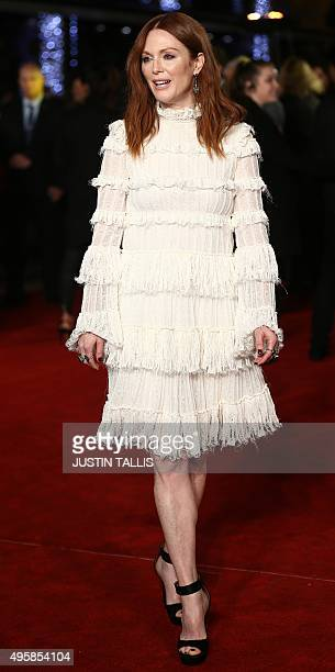 US actress Julianne Moore arrives on the red carpet to attend the UK Premiere of the film The Hunger Games Mockingjay Part 2 in central London on...