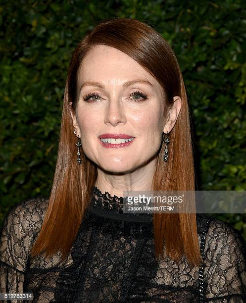 Actress Julianne Moore attends the Charles Finch and Chanel PreOscar Awards Dinner at Madeo Restaurant on February 27 2016 in Los Angeles California