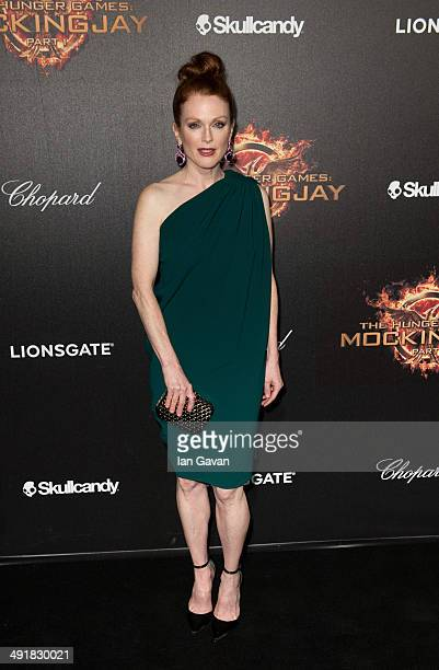 Actress Julianne Moore attends The Hunger Games Mockingjay Part 1 party at the 67th Annual Cannes Film Festival on May 17 2014 in Cannes France