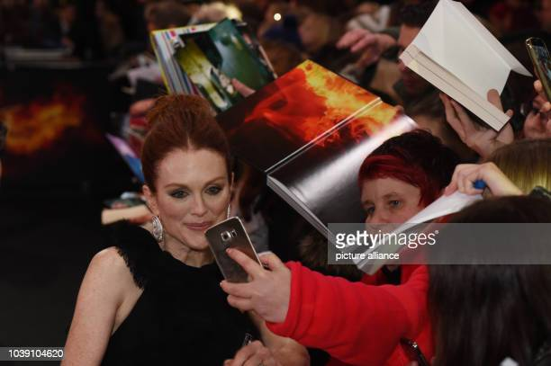 Actress Julianne Moore attends the premiere of the film 'The Hunger Games Mockingjay Part 2' in Berlin Germany 4 November 2015 Photo Jens Kalaene/dpa...