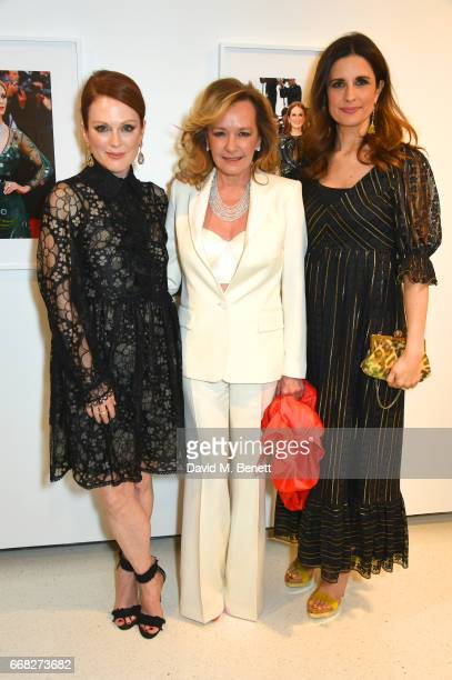 Actress Julianne Moore Chopard copresident Caroline Scheufele and EcoAge founder Livia Firth pose for a photo together as Vogue Chopard open...