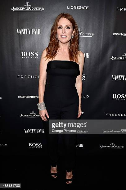 Actress Julianne Moore dressed in BOSS bespoke heavy crepe tuxedo jumpsuit with satin trim attends the Vanity Fair toast of 'Freeheld' at TIFF 2015...