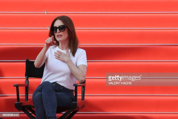 US actress Julianne Moore gestures as she takes part in the shooting of a promotional event on the red carpet outside the festival's palace on May 8...