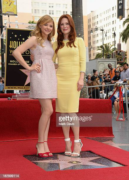 Actress Julianne Moore is joined by Chloe Grace Moretz as Moore is honored with a star on the Hollywood Walk of Fame on October 3 2013 in Hollywood...