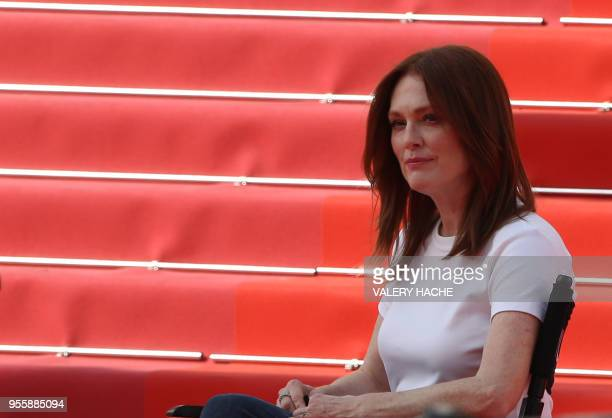 US actress Julianne Moore looks on as she takes part in the shooting of a promotional event on the red carpet outside the festival's palace on May 8...