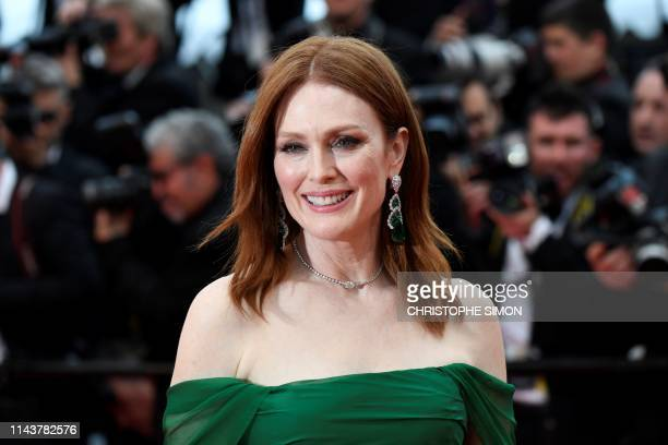 """Actress Julianne Moore poses as she arrives for the screening of the film """"The Dead Don't Die"""" during the 72nd edition of the Cannes Film Festival in..."""