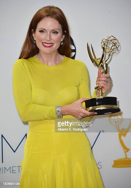 Actress Julianne Moore poses in the 64th Annual Emmy Awards press room at Nokia Theatre LA Live on September 23 2012 in Los Angeles California