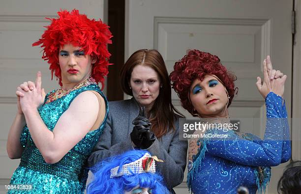 Actress Julianne Moore poses on the steps of the New College Theatre with Hasty Pudding Theatrical cast members Michael Barron and Kyle Dancewicz...