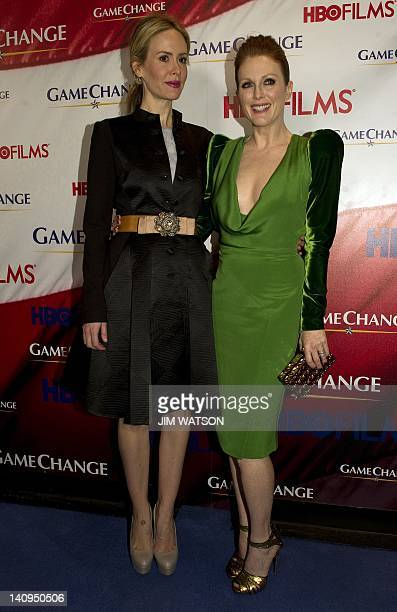 Actress Julianne Moore poses with Actress Sarah Paulson on the red carpet at the Washington DC premier of the film Game Change at the Newseum in...