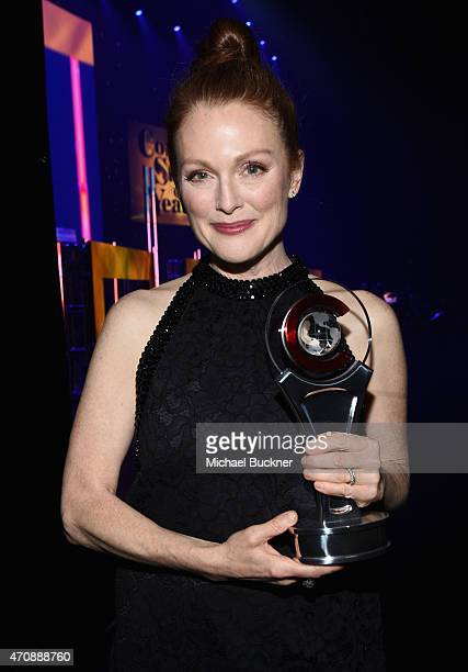 Actress Julianne Moore poses with the Vanguard Award at The CinemaCon Big Screen Achievement Awards Brought to you by The CocaCola Company at The...