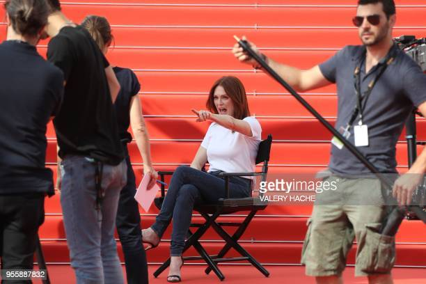 US actress Julianne Moore reacts as she takes part in the shooting of a promotional event on the red carpet outside the festival's palace on May 8...