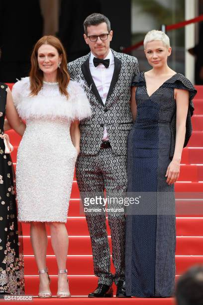 Actress Julianne Moore Screenwriter Brian Selznick and actress Michelle Williams leave the 'Wonderstruck' screening during the 70th annual Cannes...
