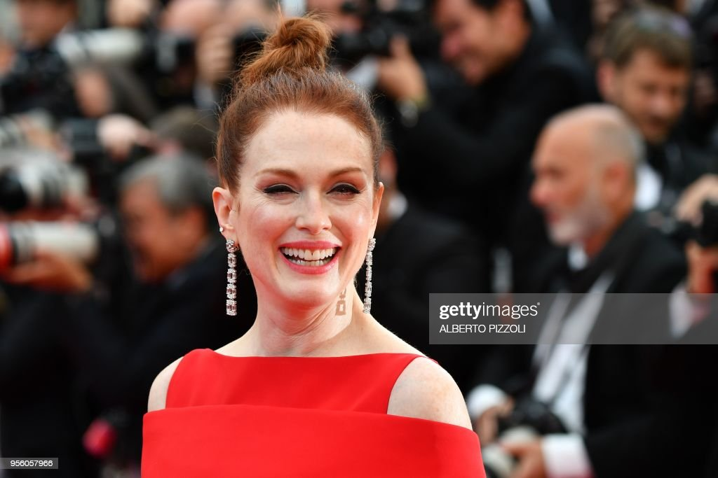 TOPSHOT - US actress Julianne Moore smiles as she arrives on May 8, 2018 for the screening of the film 'Todos Lo Saben (Everybody Knows)' and the opening ceremony of the 71st edition of the Cannes Film Festival in Cannes, southern France.