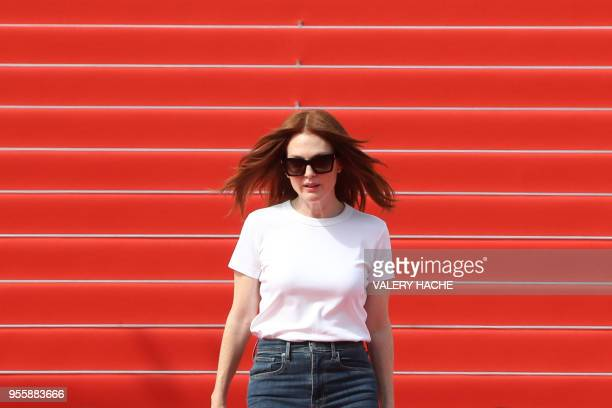 US actress Julianne Moore takes part in a promotional shooting event on the red carpet outside the festival's palace on May 8 2018 ahead of the...