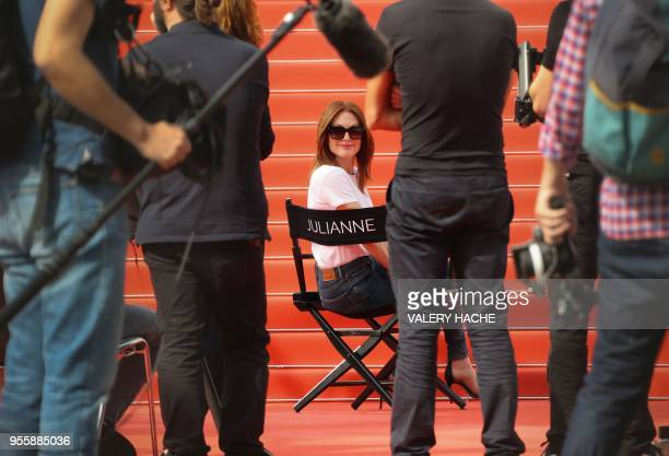 TOPSHOT US actress Julianne Moore takes part in the shooting of a promotional event on the red carpet outside the festival's palace on May 8 2018...