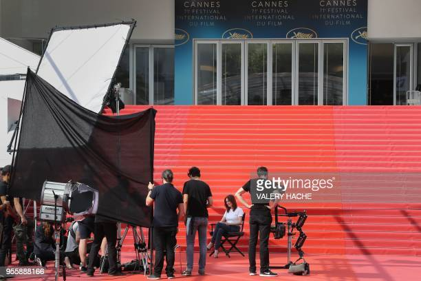 US actress Julianne Moore takes part in the shooting of a promotional event on the red carpet outside the festival's palace on May 8 2018 ahead of...