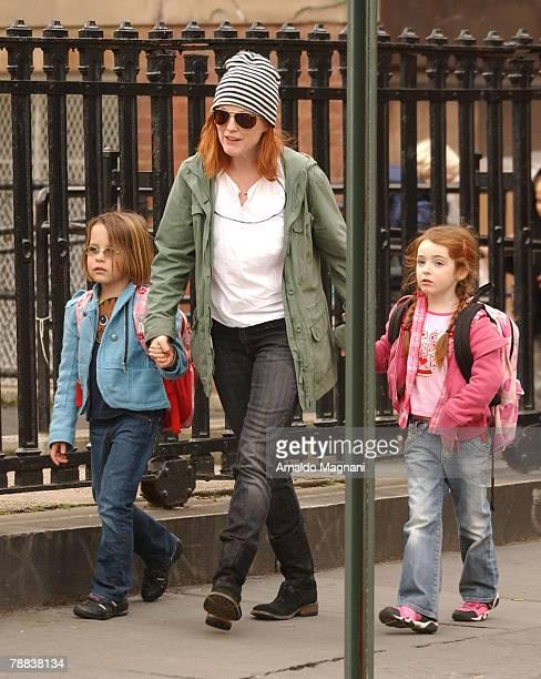 Actress Julianne Moore walks with her daughter Liv Helen Freundlich January 8 2008 in New York City