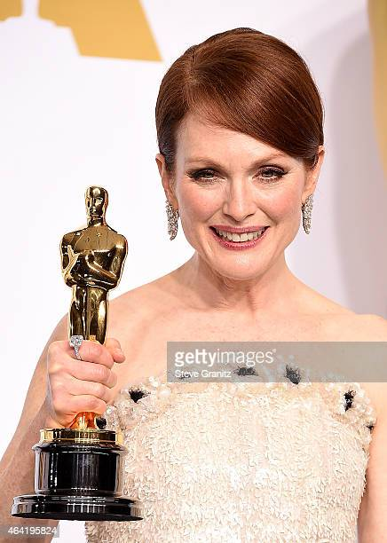 Actress Julianne Moore winner for the Best Actress in a Leading Role Award for 'Still Alice' poses in the press room during the 87th Annual Academy...