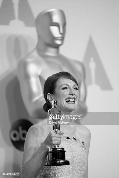 Actress Julianne Moore winner for the Best Actress in a Leading Role Award for 'Still Alice' appears in the press photo room at the 87th Annual...