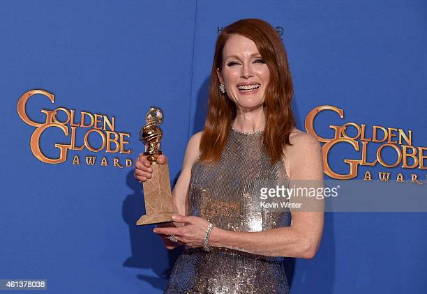 Actress Julianne Moore winner of Best Actress in a Motion Picture Drama for 'Still Alice' poses in the press room during the 72nd Annual Golden Globe...