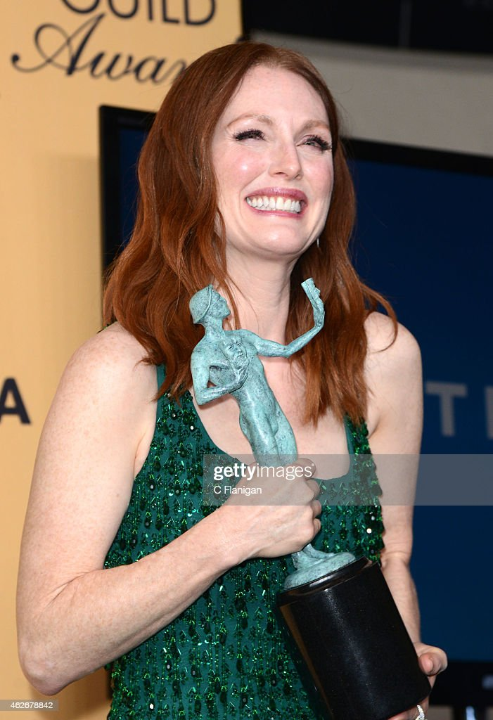 Actress Julianne Moore, winner of Outstanding Performance by a Female Actor in a Leading Role for 'Still Alice,' poses in the press room during the 21st Annual Screen Actors Guild Awards at The Shrine Auditorium on January 25, 2015 in Los Angeles, California.