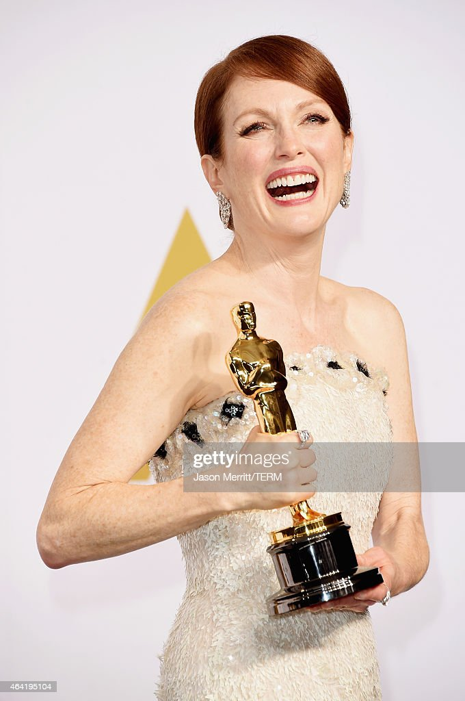Actress Julianne Moore winner of the Best Actress in a Leading Role Award for 'Still Alice' poses in the press room during the 87th Annual Academy Awards at Loews Hollywood Hotel on February 22, 2015 in Hollywood, California.