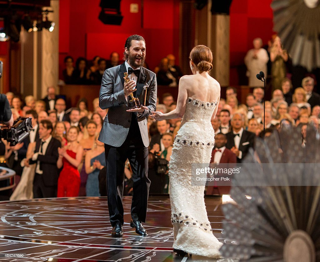 Actress Julianne Moore, winner of the Best Actress in a Leading Role Award for 'Still Alice', (R) and actor Matthew McConaughey appear onstage at The 87th Annual Academy Awards at Hollywood & Highland Center on February 22, 2015 in Hollywood, California.
