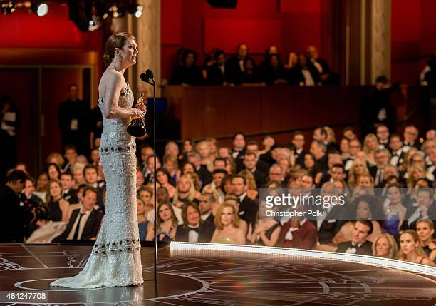 Actress Julianne Moore winner of the Best Actress in a Leading Role Award for 'Still Alice' appears onstage at the 87th Annual Academy Awards at...