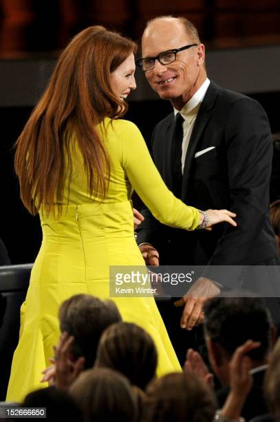 Actress Julianne Moore wins Outstanding Lead Actress in a Miniseries or a Movie for Game Change with actor Ed Harris during the 64th Annual Primetime...