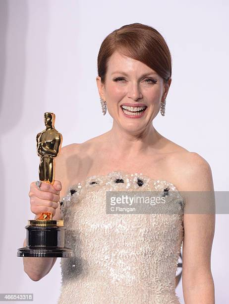 Actress Julianne Moore with the award for best actress for 'Still Alice' poses in the press room during the 87th Annual Academy Awards at Loews...
