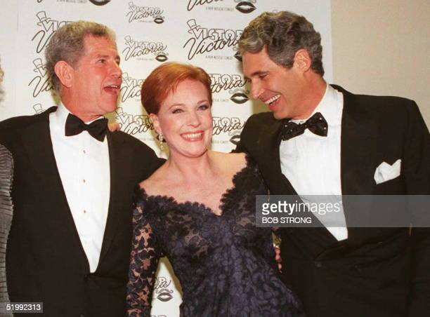 Actress Julie Andrews is joined by cast members Tony Roberts and Michael Nouri following the opening of the musical Victor/Victoria 26 October in New...