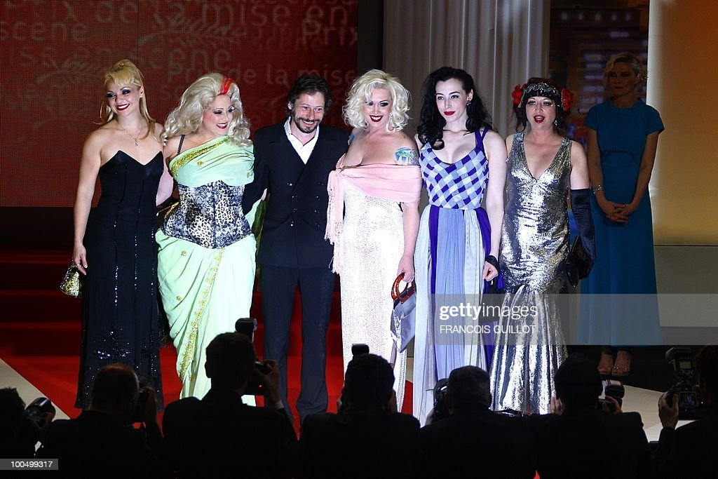actress Julie Atlas Muz, actress Dirty Martini, French director and actor Mathieu Amalric, actress Mimi Le Meaux, actress Evie Lovelle and actress Kitten on the Keys pose after Mathieu Amalric won the Best Director award for his film 'Tournee' (On Tour) during the closing ceremony at the 63rd Cannes Film Festival on May 23, 2010 in Cannes.