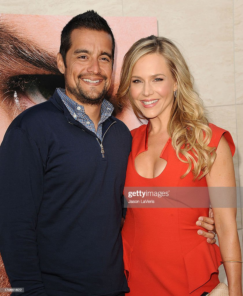 Actress Julie Benz (R) and husband Rich Orosco attend the 'Dexter' series finale season premiere party at Milk Studios on June 15, 2013 in Hollywood, California.
