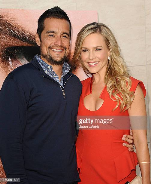 Actress Julie Benz and husband Rich Orosco attend the 'Dexter' series finale season premiere party at Milk Studios on June 15 2013 in Hollywood...