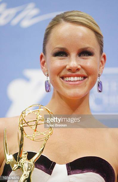 Actress Julie Berman poses with the Outstanding Younger Actress Award in the trophy room at the 37th Annual Daytime Entertainment Emmy Awards held at...
