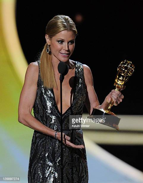 Actress Julie Bowen accepts the Outstanding Supporting Actress in a Comedy Series award onstage during the 63rd Annual Primetime Emmy Awards held at...